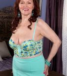 Busty mature redhead Katherine Merlot giving titjob after foot worship from man