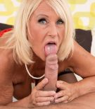 Hot over 60 MILF Regi making love to younger man in lingerie and stockings