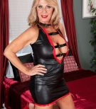 Leggy over 60 blonde escort Phoenix Skye giving client oral sex in red high heels