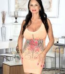 Over Sixty brown-haired MILF Rita Daniels showcasing great legs and enormous breasts