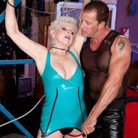 60+ granny Jewel engages in kinky BDSM sex games while bound in latex outfit