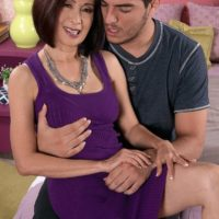 Hot Asian granny Kim Anh riding a younger man's cock