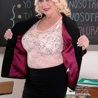 Hot over 60 schoolteacher Angelique DuBois baring big tits in classroom