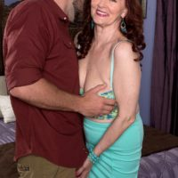Experienced redhead Katherine Merlot exposing large saggy over 60 breasts