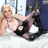 Blond grandma Charlie lets out her gigantic juggs in over the knee boots and fishnet body-stocking