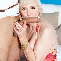 Chesty short haired granny Lola Lee delivering large rod blow-job and tit banging in tights