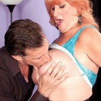 Gawky redhead granny Jackie having monster-sized boobs sucked before giving huge dick oral jobs