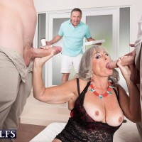 Older dame Silva Foxx gives TWO studs oral sex in front of her cuck spouse