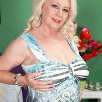 Plump blond MILF over 60 Angelique DuBois extracting pierced nips and monster-sized juggs