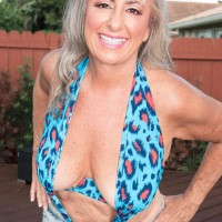 Sexy Sixty plus MILF Silva Foxx entices a junior man by showcasing her boobies in a denim micro-skirt