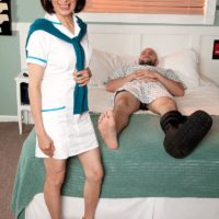 Uniformed sixty plus Asian MILF nurse Kim Anh delivering huge sausage HJ in hospital