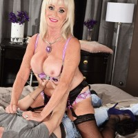 Yellow-haired grandma Leah L'Amour gives her guy toy a hj in lingerie and pantyhose