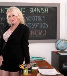 Nylon and high heel attired 60 plus teacher Angelique DuBois baring big knockers