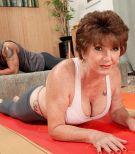 Barefoot and yoga pants clad MILF over 60 Bea Cummins having big tits set free