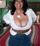 Brunette MILF over 60 Rochelle Sweet having huge mature juggs exposed in skirt