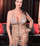 Experienced dark haired XXX pornstar Rita Daniels showing off no panty upskirt during boob sucking