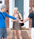 Sandy-haired granny Cammille Austin wanks a pair of sausages after seducing studs in a sundress