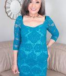 60 plus grannie Kokie Del Coco seduces a junior guy in a short dress on the sofa