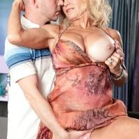 Busty blonde over 60 MILF Cara Reid baring huge knockers before sex