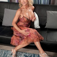Hot 60 + blonde has her great tits freed from a slinky dress by her younger lover