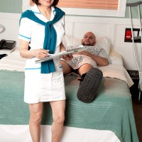 Over MILF Kim Anh flashing nice Asian tits and jerking cock in hospital room
