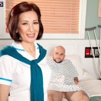 Petite Asian MILF over 60 Kim Anh jerking off massive cock on hospital bed