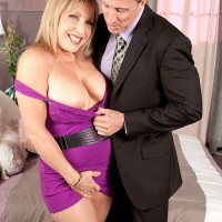 Hot older woman with great legs is relieved of a purple dress by her man friend