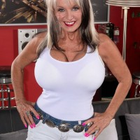 Chesty over 60 babe Sally D'Angelo strutting fully clothed in denim shorts