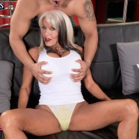 Sexy 60 + blonde has her huge boobs freed from a tank top buy her Latino lover