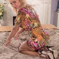 Over sixty blonde granny Cara Reid letting big knockers loose in bedroom