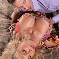 Blonde over 60 MILF has her firm boobs freed from a dress by her younger lover