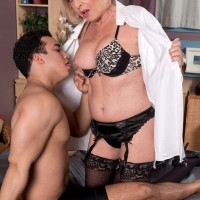 Over 60 mom Scarlet Andrews seducing younger man in black stockings and garters