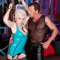 Latex attired over 60 MILF Jewel bound on bondage table for mature BDSM sex