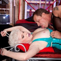 Hot nan with short hair submits to her BDSM dreams with a younger guy in latex