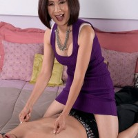Over 60 Asian MILF Kim Anh giving massage and pinching nipples in high heels