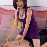 60+ Asian pornstar Kin Anh flashing white panties and riding cock