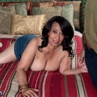 Brunette MILF over 60 Rochelle Sweet having huge mature juggs exposed in skirt