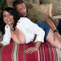 Sixty plus woman Rochelle Sweet has her large boobs played with by her lover