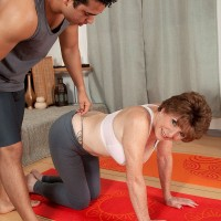 barefoot 60 plus MILF Bea Cummins works out in yoga pants before baring big tits