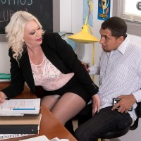 Nylon and high heel attired 60 plus teacher Angelique DuBois baring big knockers