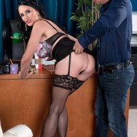 Stocking and skirt garbed over 60 MILF Rita Daniels seducing big cock in office