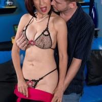 Mature Asian pornstar Kim Anh exposing nice mature tits before sex with stud