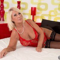 Gorgeous over 60 granny Regi posing in sexy lingerie while giving a blowjob