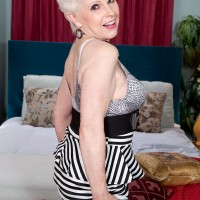 Hot over sixty granny Jewel exposing natural GILF tits before sex with young stud
