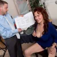 Mature 60+ redheaded pornstar Katherine Merlot letting large saggy tits loose