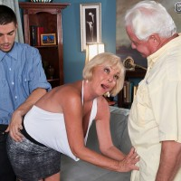 Hot sixty plus woman with blonde hair does a younger guy in front of her hubby