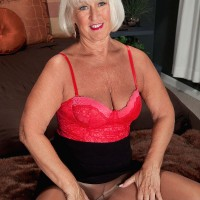 Sexy over 60 granny Jeannie Lou flashes crotchless panties before taking hardcore DP