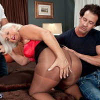 Older woman entertains a couple of her younger lovers at once in pantyhose