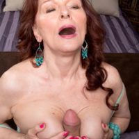 Over 60 cougar Katherine Merlot stripping down to nylons before tit fucking cock
