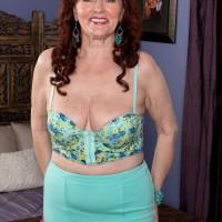 Redheaded over 60 MILF Katherine Merlot unleashing large tits for tit fucking
